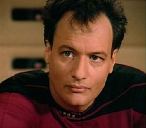 Q (John de Lancie in Star Trek) face closeup in Federation uniform