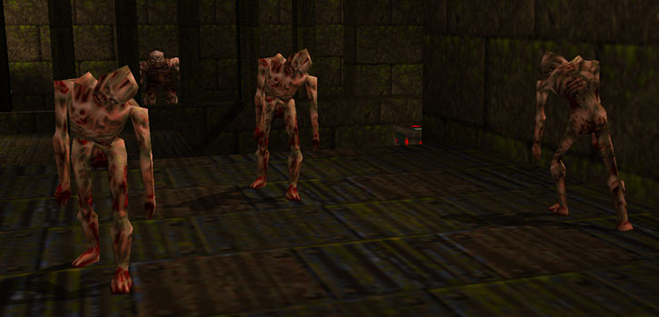 A trio of zombies in Quake