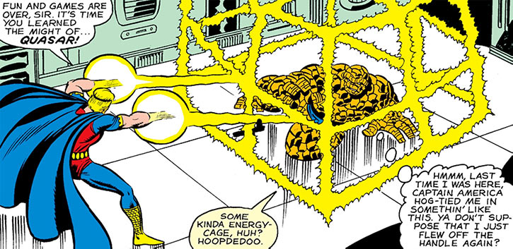 Quasar (Marvel Comics) (Vaughn) (Classic) - holds the Thing in an energy cage