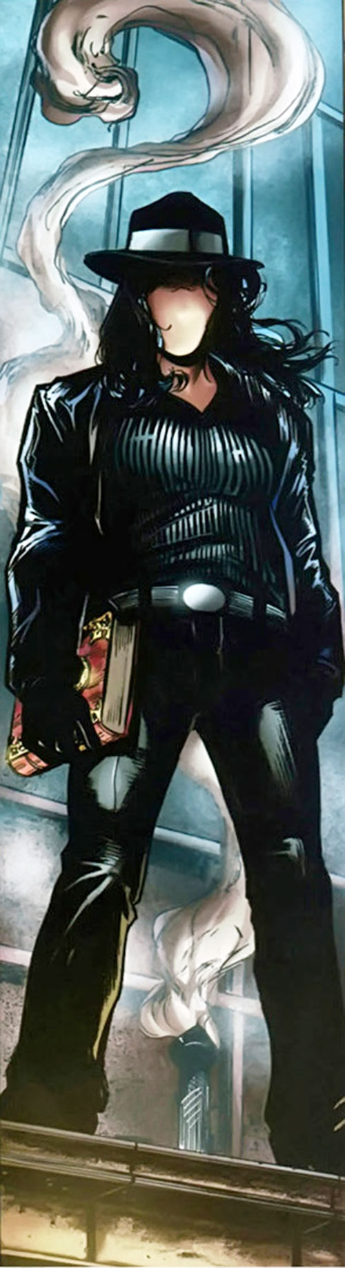 Question (Renee Montoya) (DC Comics) on a ledge holding the crime bible