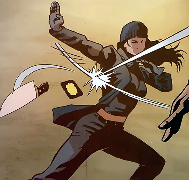 The Question (Renee Montoya) deflects a thrown knife