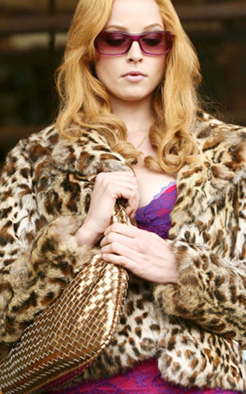 Rachel Gibson (Rachel Nichols in Alias) with pink sunglasses and a leopard fur vest