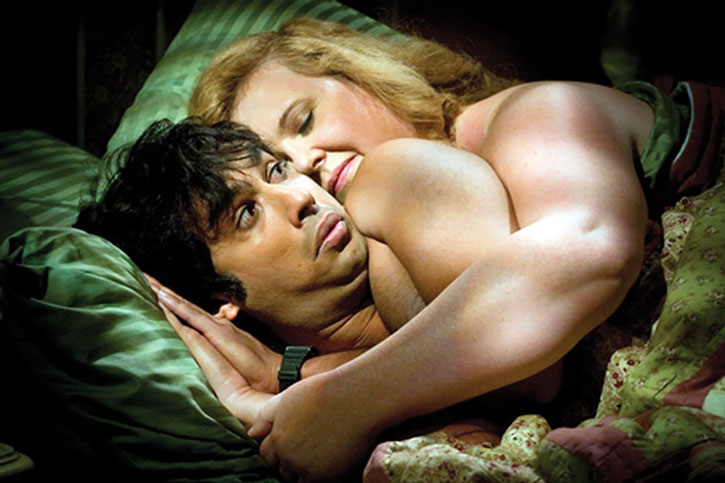 Rajesh in bed with a blonde woman