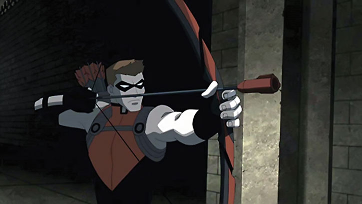 Red Arrow draws his bow in a dark tunnel