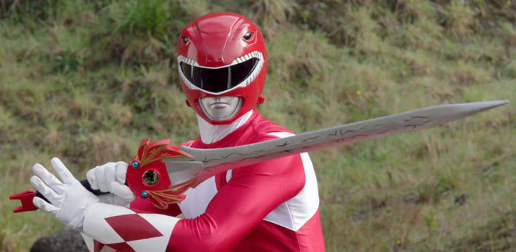 Red Ranger (Jason) of the Mighty Morphin Power Rangers - posing with sword, grass