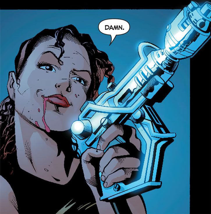 Renee Montoya bleeding and holding an Apokolips pistol