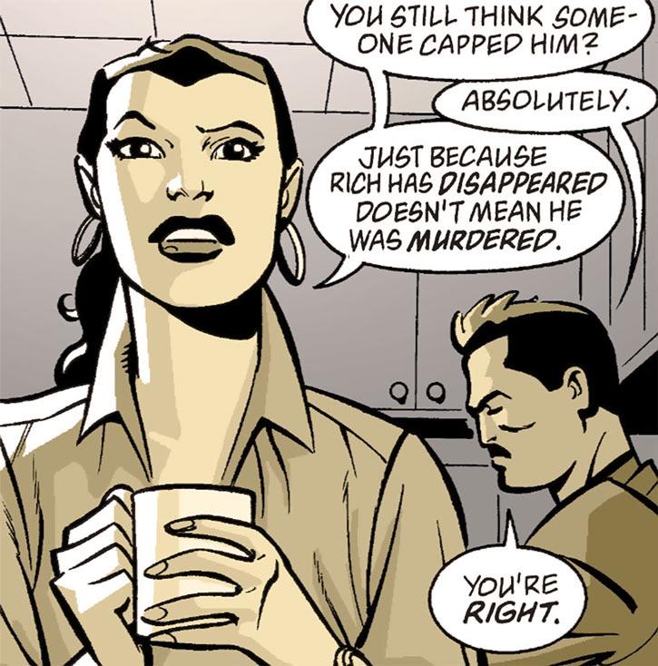 Renee Montoya talking with a mug of coffee