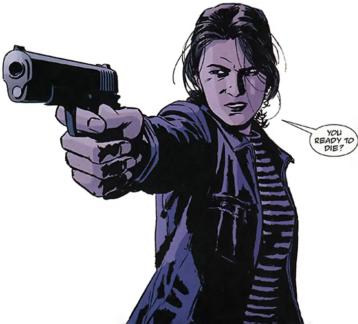 Renee Montoya pointing her pistol, over a white background