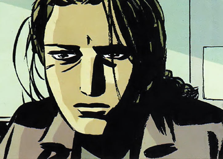 Renee Montoya looking haunted and exhausted