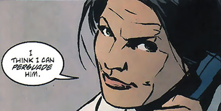 Renee Montoya grinning on the phone