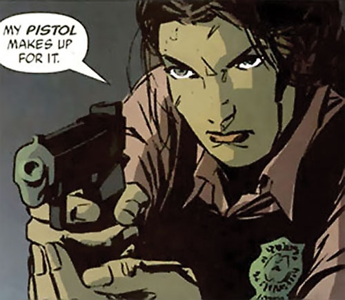 Renee Montoya (Gotham Central and 52 eras) (DC Comics) with a badge aiming her pistol