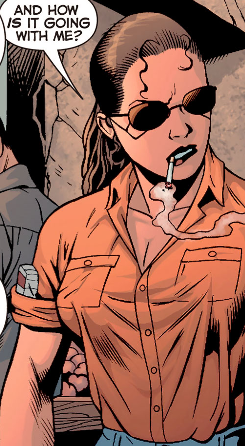 Renee Montoya (Gotham Central and 52 eras) (DC Comics) smoking in an orange shirt