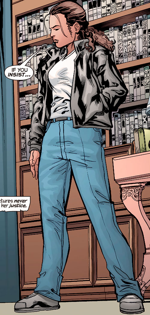 Renee Montoya (Gotham Central and 52 eras) (DC Comics) standing before a bookcase