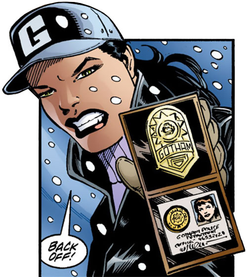 Renee Montoya (Batman ally) (DC Comics) during the early 2000s - brandishing her badge