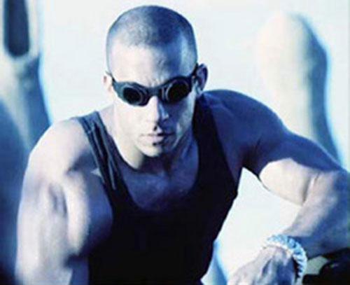 Riddick (Vin Diesel) crouching