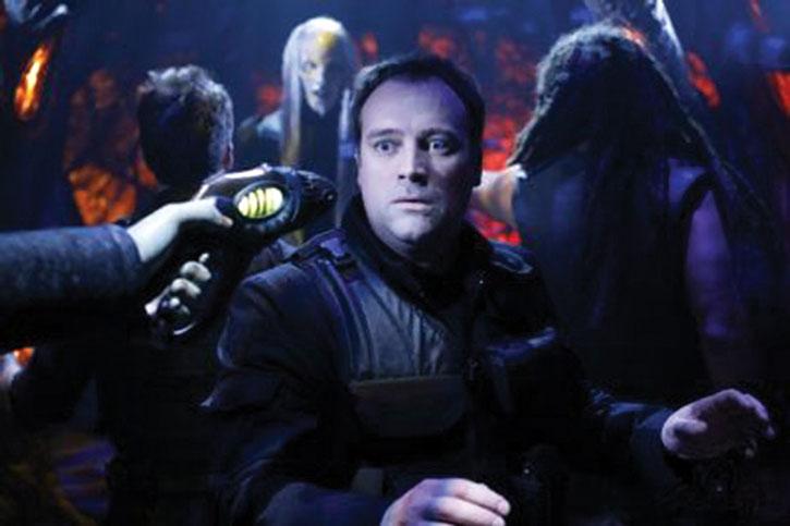 Rodney McKay (David Hewlett) threatened with an alien gun