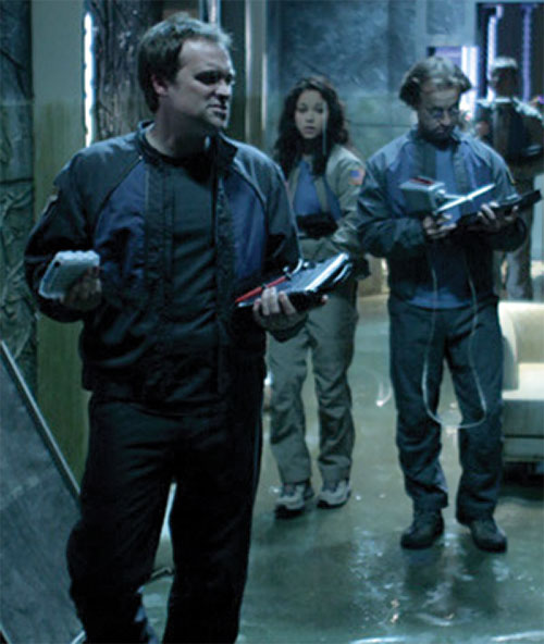 Rodney McKay (David Hewlett in Stargate Atlantis) working with colleagues