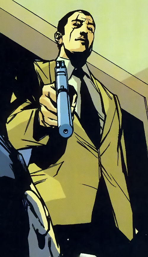 Roque of the Losers (DC Comics) pointing a silenced pistol