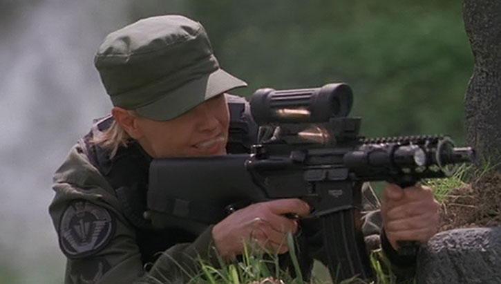 Samantha Carter (Amanda Tapping) with her custom assault carbine