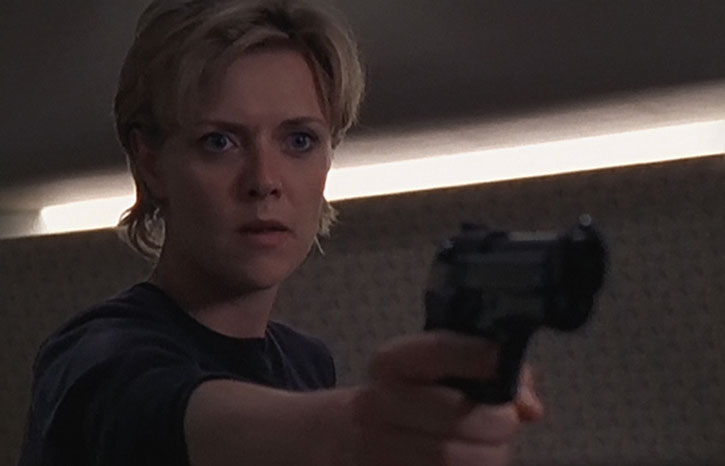 Samantha Carter (Amanda Tapping) with a pistol