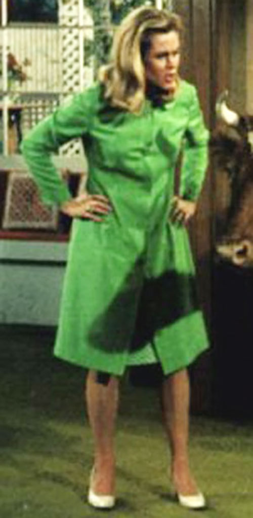 Samantha Stephens (Elizabeth Montgomery in Bewitched) in a bright green raincoat and skirt