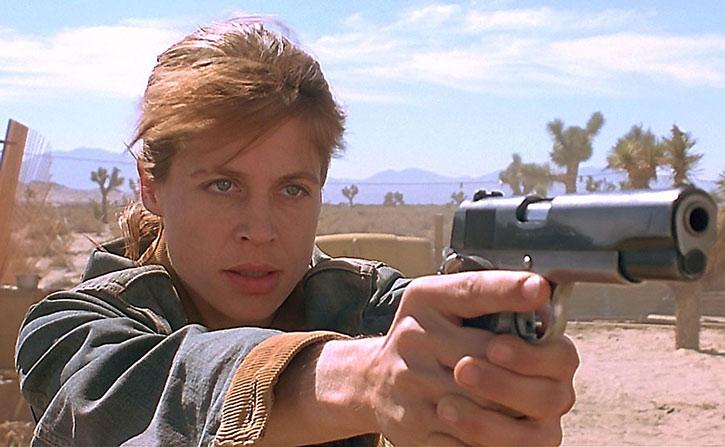 Sarah Connor (Linda Hamilton) aiming a .45 pistol