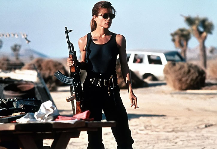 Sarah Connor (Linda Hamilton) with an assault rifle in the desert