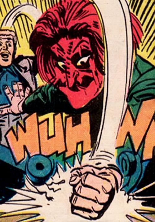 Scarlet Mask (Boris Karloff comics) smashing a telephone