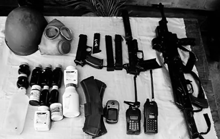 Photo of an arsenal with guns and other supplies