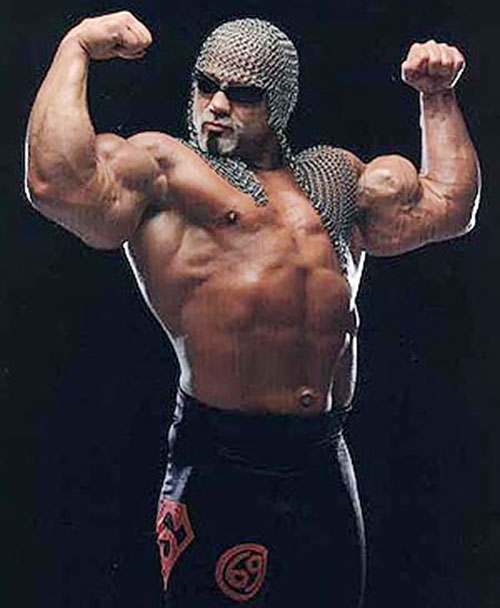 Scott Steiner flexing with his headgear