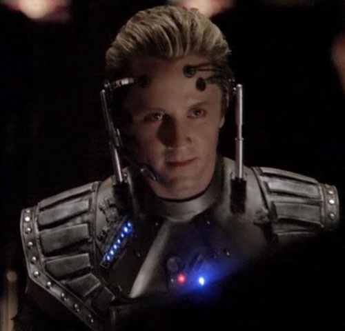 Seamus Harper (Gordon Michael Woolvett in Andromeda) with cyber-armor