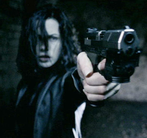 Selene (Kate Beckinsale in Underworld movies) aims a pistol