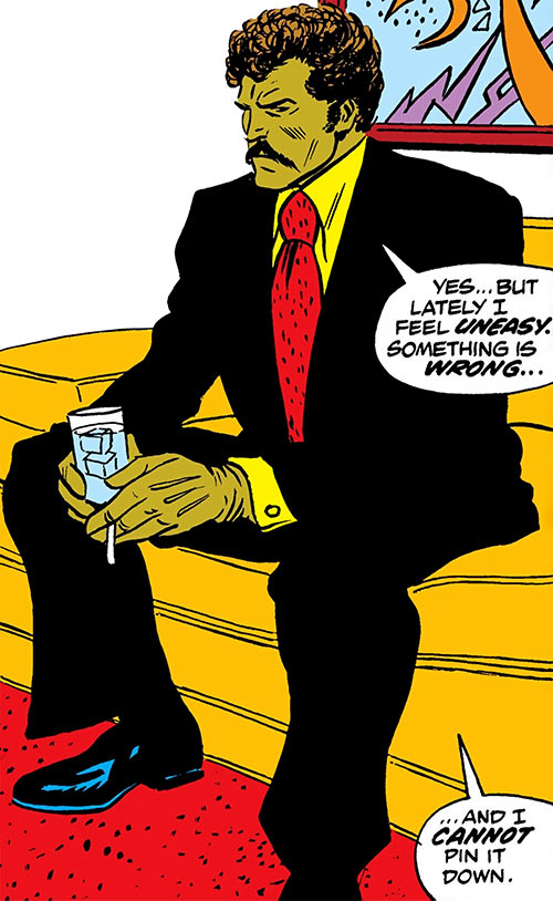 Senor Suerte Muerte (Luke Cage enemy) (Marvel Comics) sitting with a drink in a suit