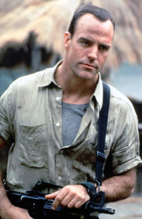 Richard Burgi (The Sentinel) with an assault carbine and green shirt