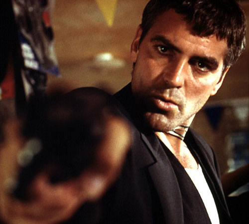 Seth Gecko (George Clooney in From Dusk Till Dawn) pointing a gun