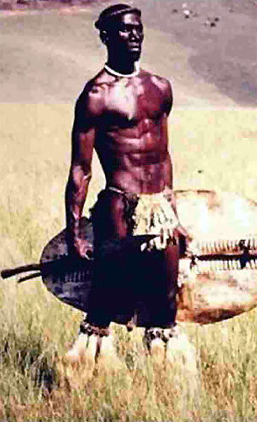 Shaka Zulu (Henry Cele) with loincloth, boots and shield