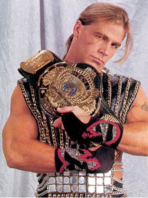 Shawn Michaels the Heartbreak Kid cradling a trophy belt
