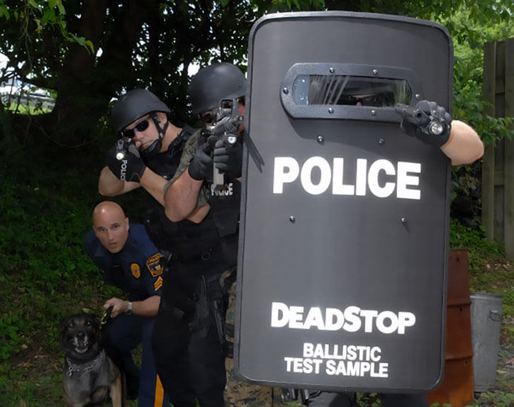 Tactical police with a deadstop ballistic shield