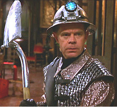 Shoveler (William Macy in Mystery Men) raising his shovel