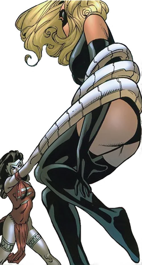 Silverclaw of the Avengers (Marvel Comics) catching Ms. Marvel in her coils