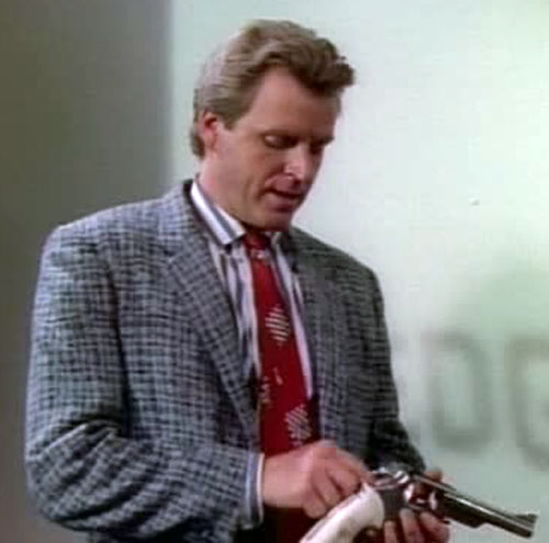 Sledge Hammer (David Rasche) taking care of his gun