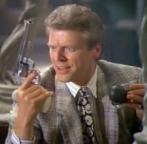 Sledge Hammer (David Rasche) talks to his gun