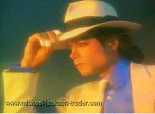 Smooth Criminal holding on to his hat