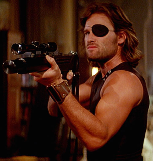 Snake Plissken (Kurt Russell in Escape from New York) pointing his submachinegun