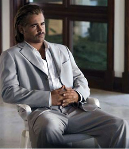 Sonny Crockett (Colin Farrell in Miami Vice) sitting in a light grey suit
