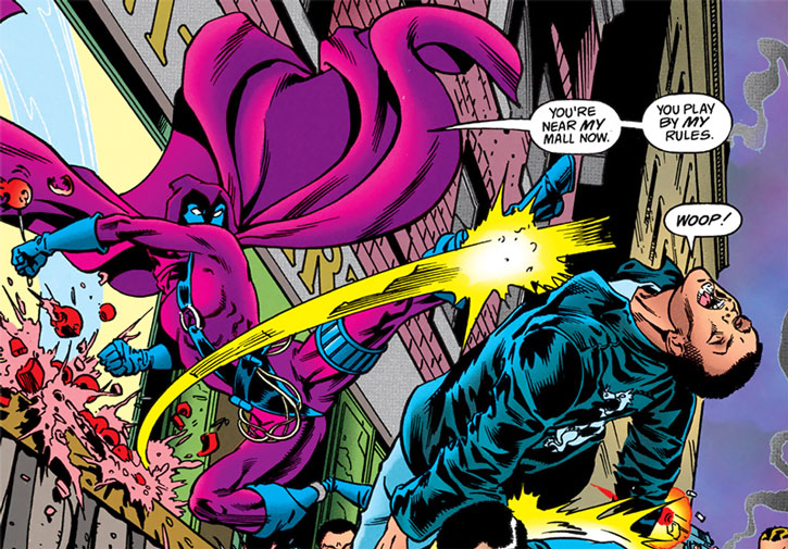 Spoiler (Stephanie Brown) kicking a gang member