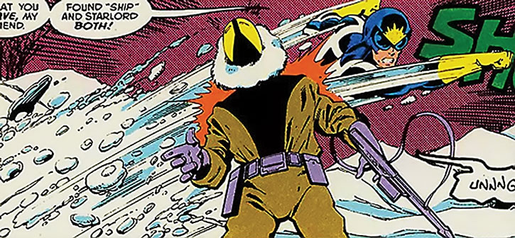Starlord (Peter Quill) erupts from snow and punches a soldier