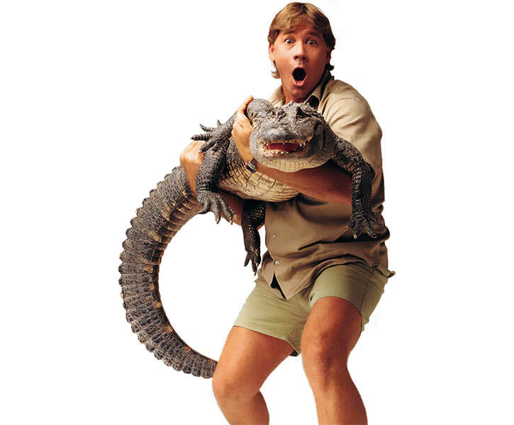 Steve Irwin the Crocodile Hunter carrying a croc