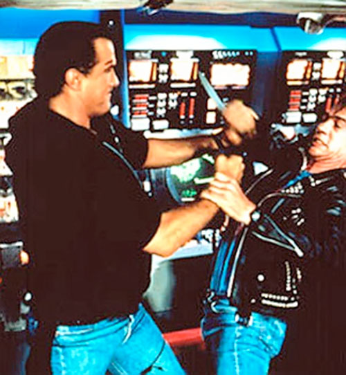 Steven Seagal fights a guy with a knife