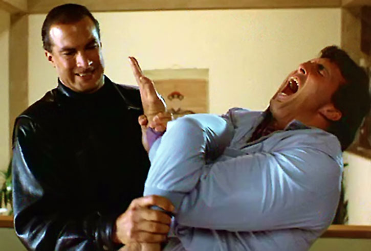Steven Seagal breaks a man's arm